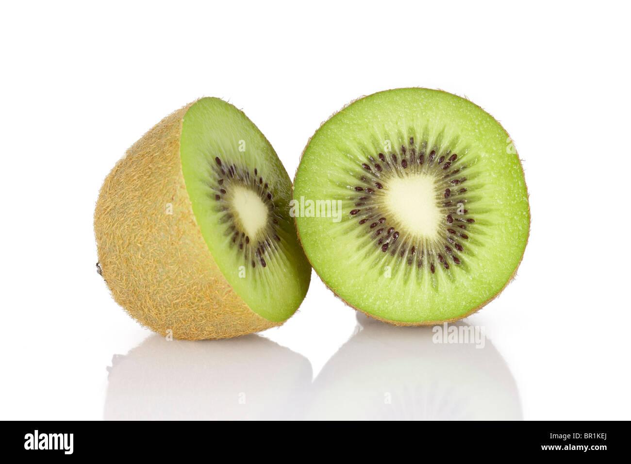 Kiwi half and round slice macro on a white background - Stock Image