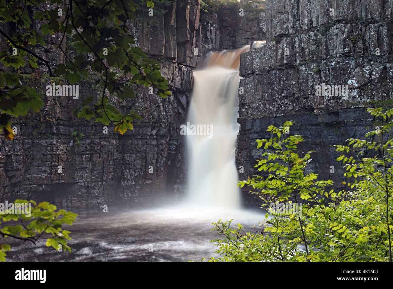 The River Tees Flowing Over High Force Waterfall Upper Teesdale County Durham UK - Stock Image