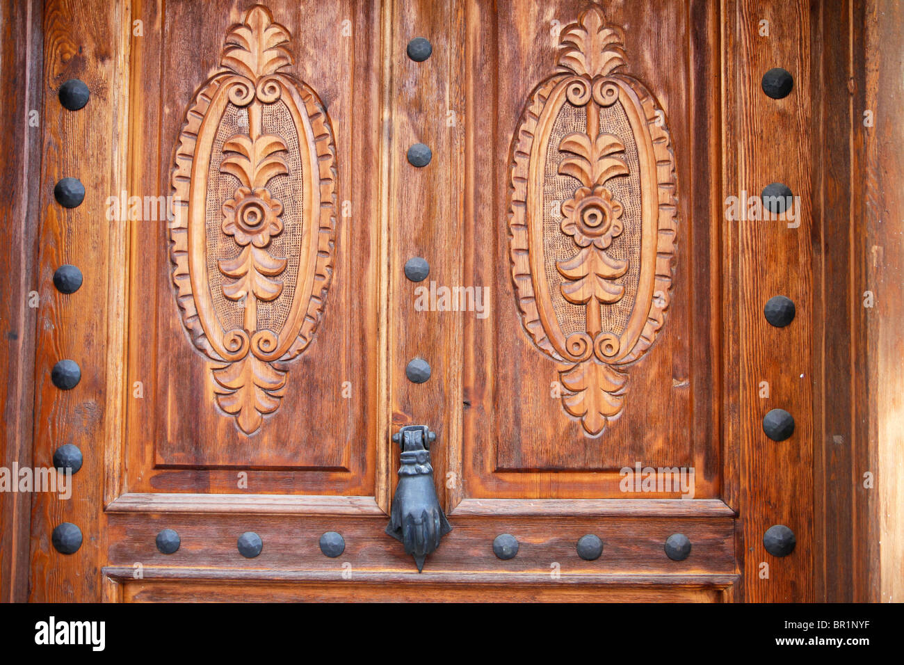 Detail of ornate wooden door to house in Kas Old Town, Turkey - Stock Image