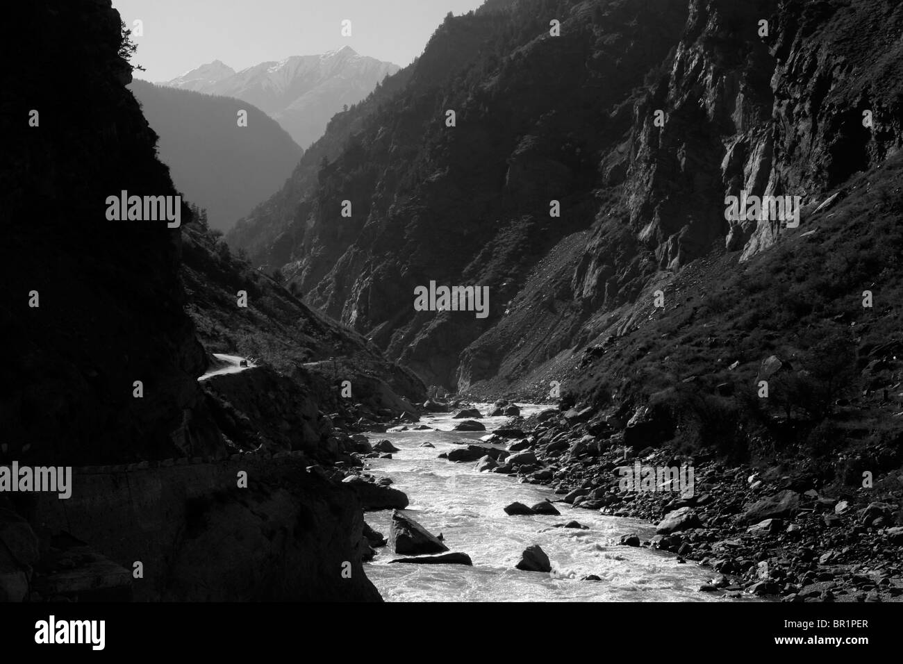 A view of the Sutlej river and a dramatic road which follows it in Himachal Pradesh in the Himalayas of northern - Stock Image