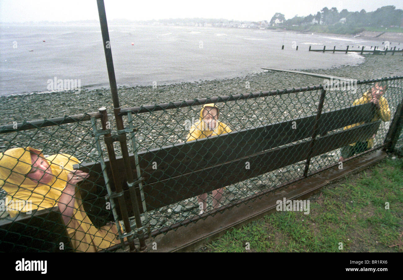 Pam Kettman, Leontine and Al Pietruska install a storm barrier in preparation for hurricane Floyd at Point Beach - Stock Image