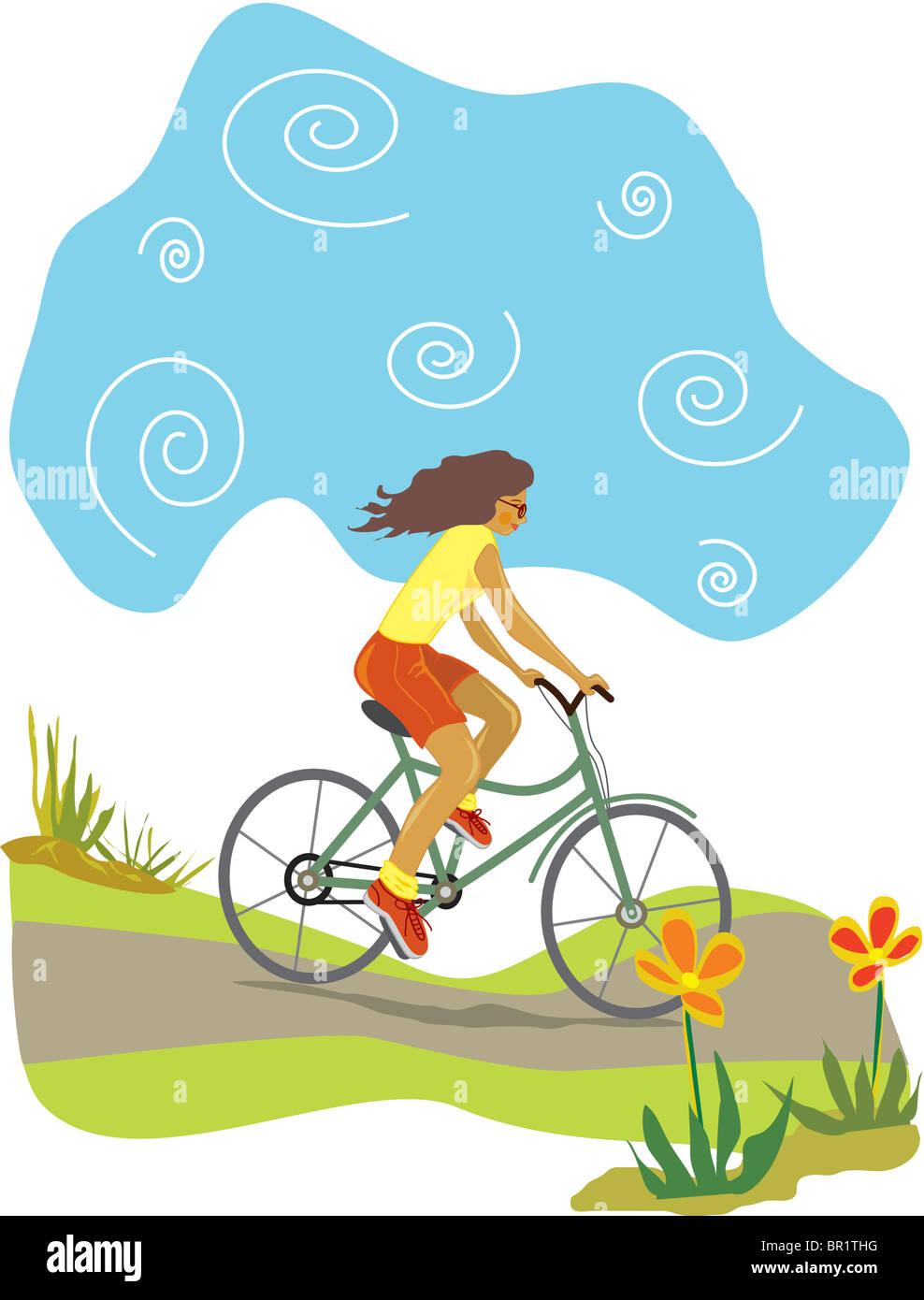 A woman riding her bike downhill Stock Photo