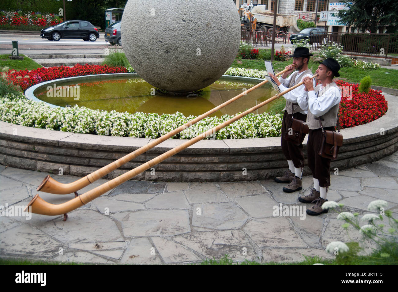 two alpen horn players at Sevrier - Stock Image