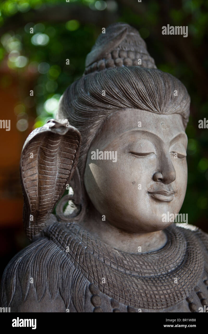 Buddha statue with snake - Stock Image