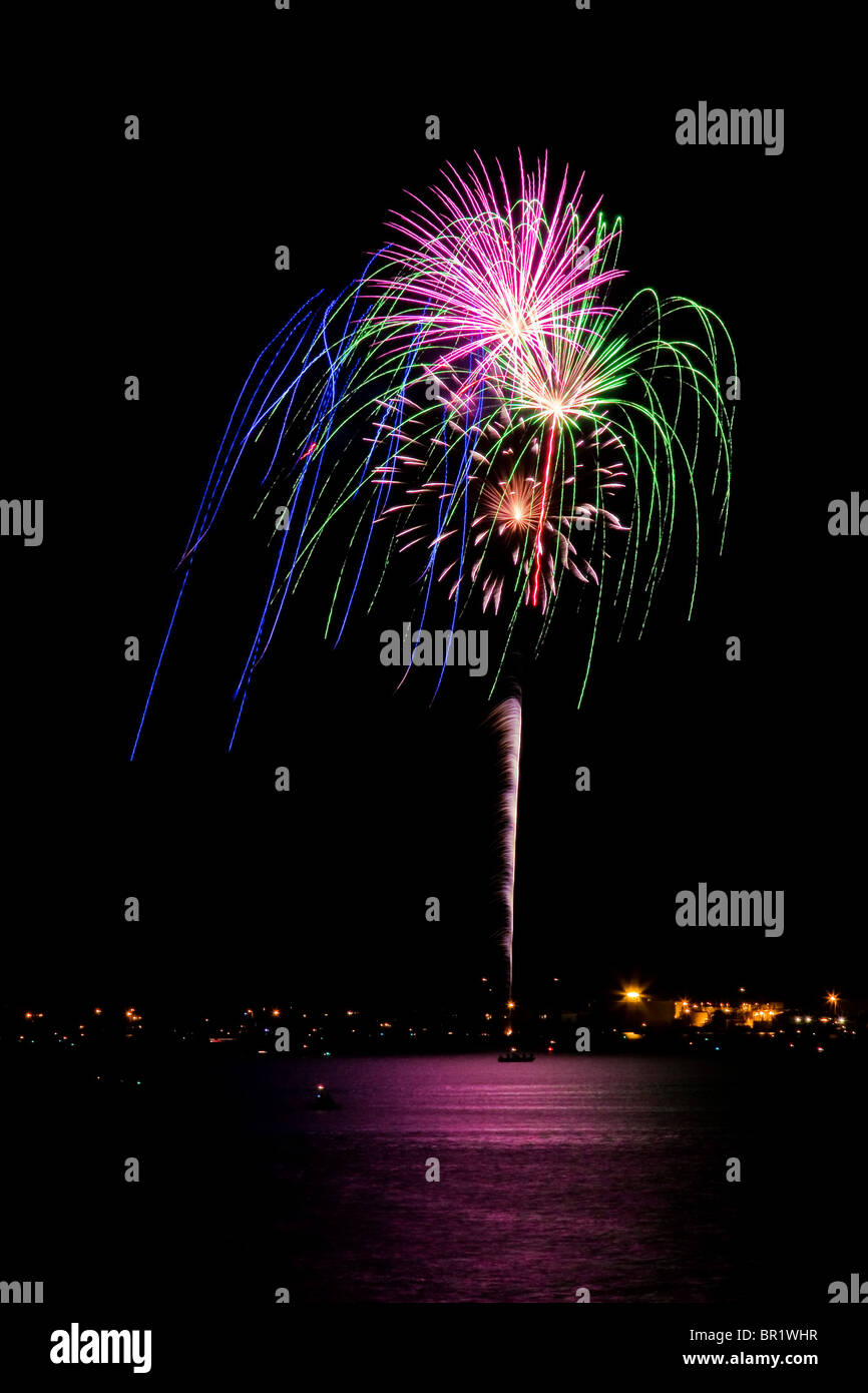 Fireworks display on Fourth of July at beach Stock Photo