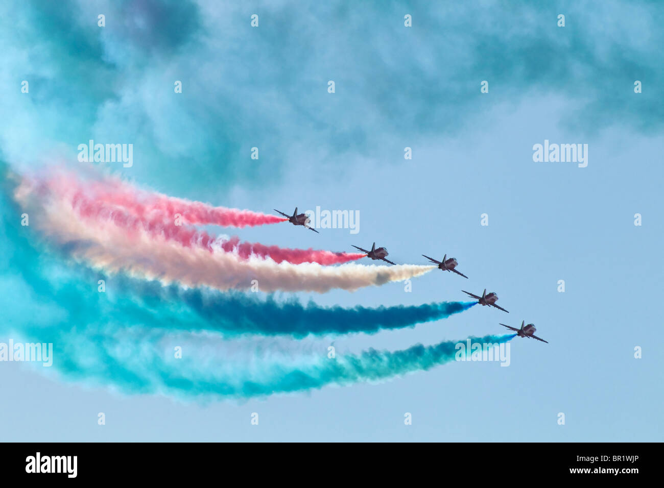 Display smoke from the RAF's Red Arrows formation aerobatic team - Stock Image