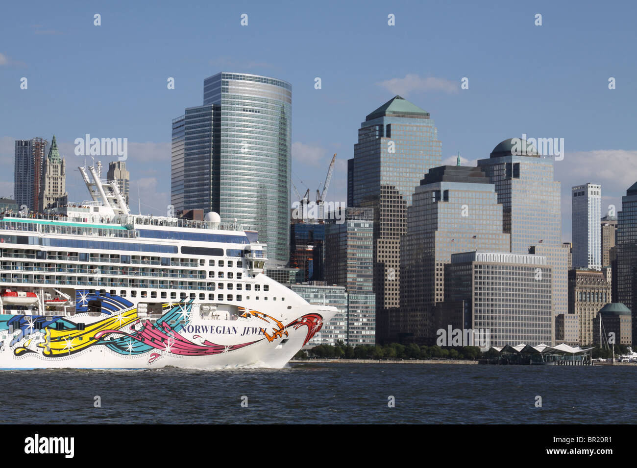 New York City- September 4, 2010-Nowegian Jewel cruise ship approching Ground Zero on the Hudson River. - Stock Image