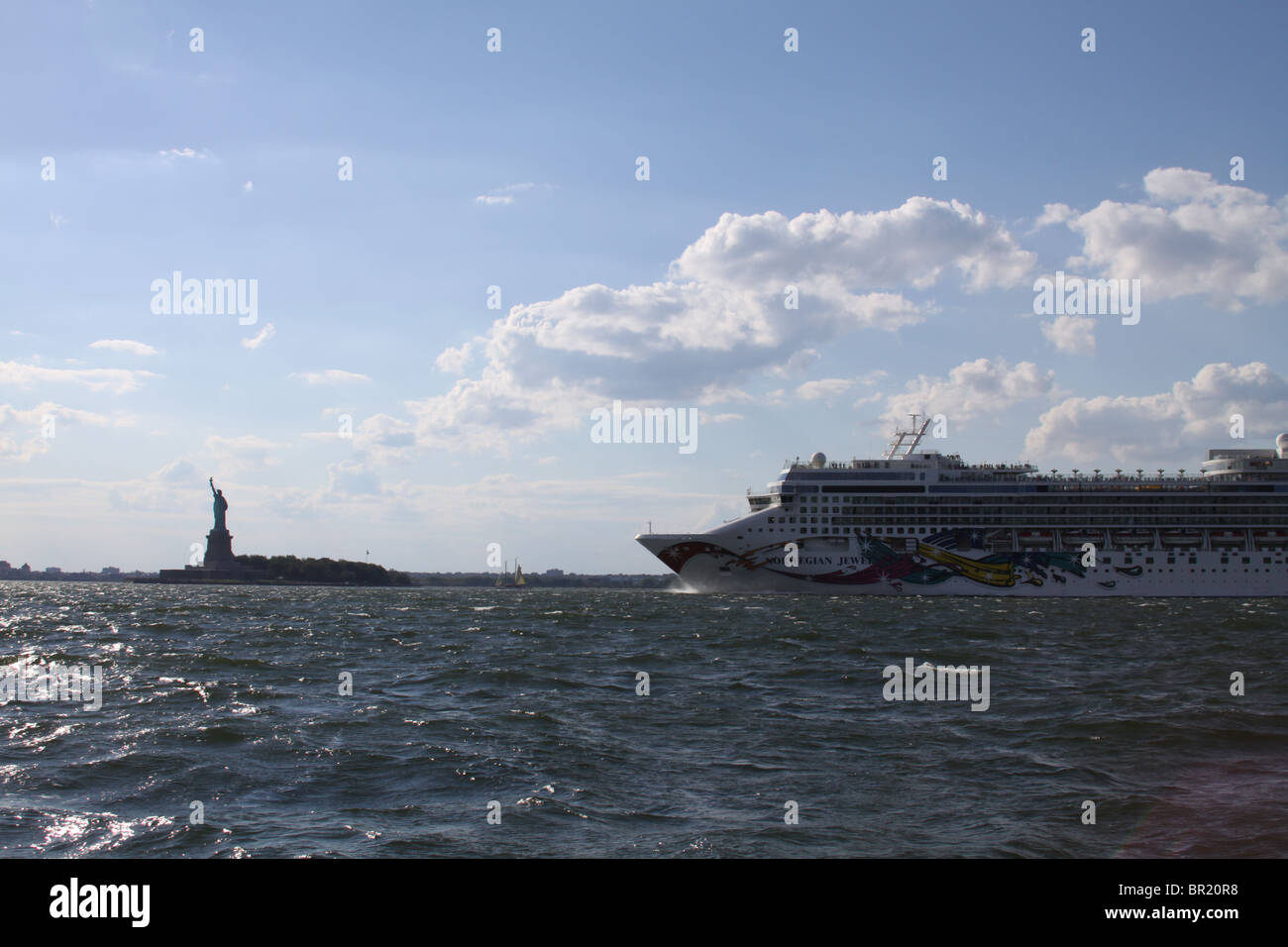 New York-September 4, 2010- Nowegian Jewel cruise ship approching the Statue of Liberty on Hudson River - Stock Image