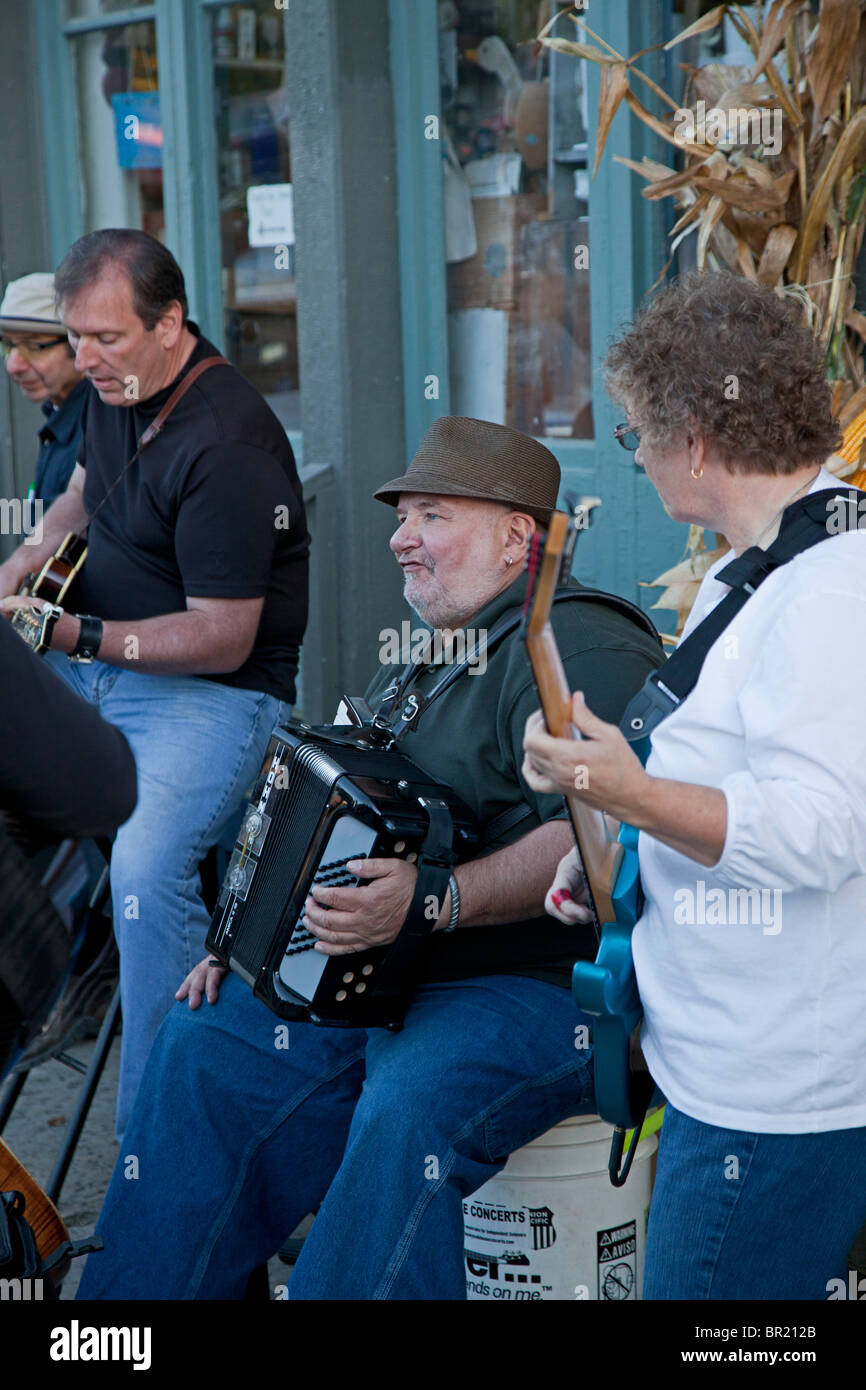 Metamora, Indiana - A bluegrass band plays on the street during the Old Time Music Festival in Metamora, Indiana. - Stock Image