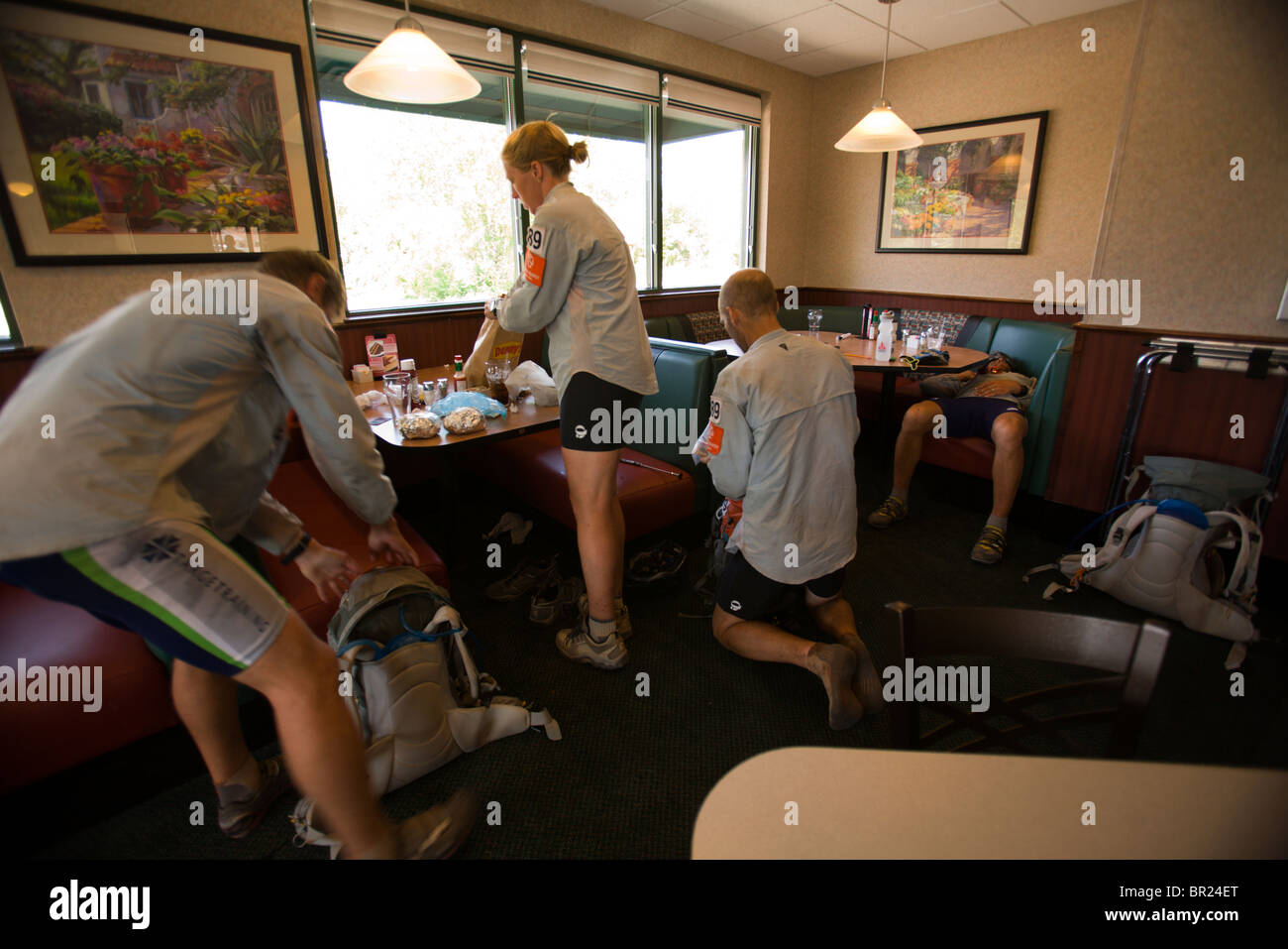 Team members getting geared up at a restaurant during an adventure race near Moab, Utah. - Stock Image