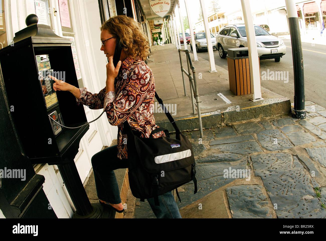 Woman makes a phone call. Springfield, California, USA - Stock Image