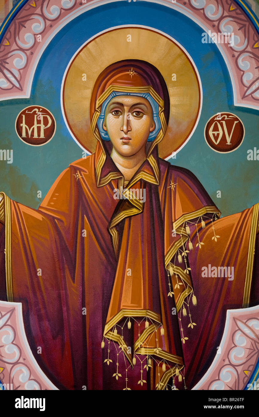 Mother Mary fresco open arms hads church wall Greece look