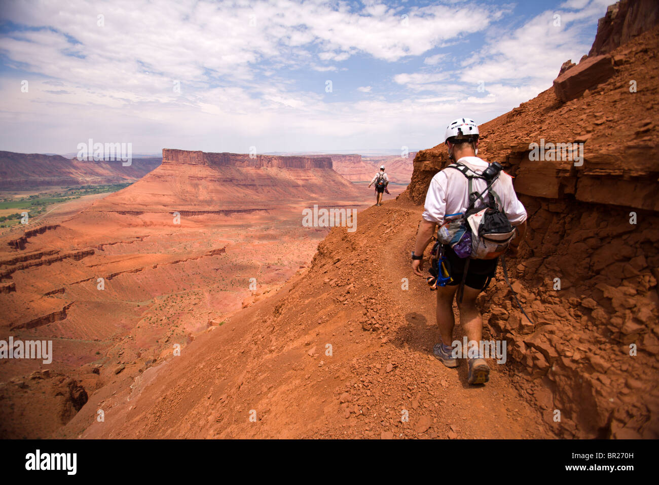 Adventure racers hiking along a high trail in a race in Moab, Utah (Silhouette). - Stock Image