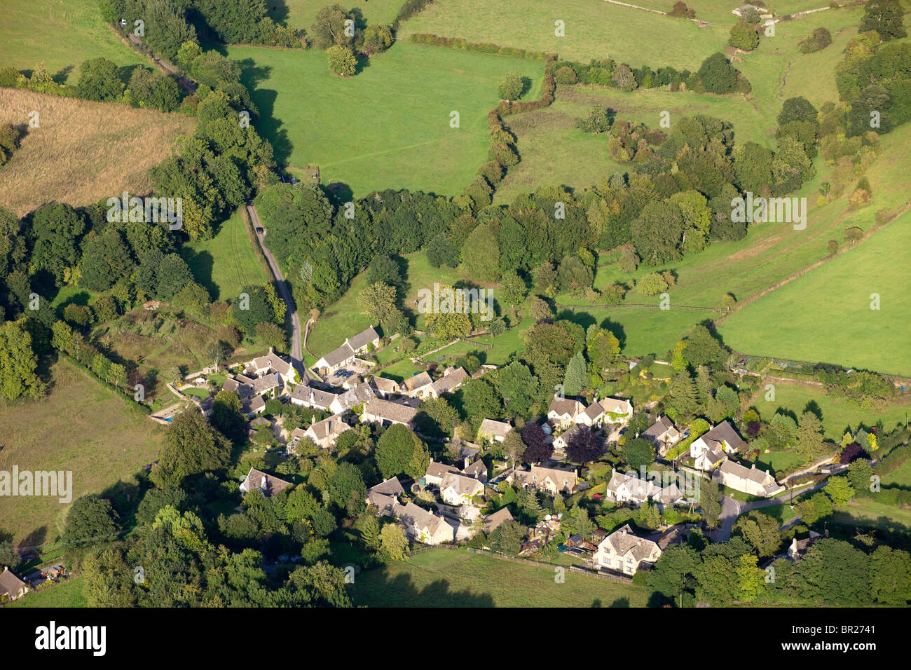 An aerial view of the Cotswold village of Duntisbourne Leer, Gloucestershire from the west. - Stock Image