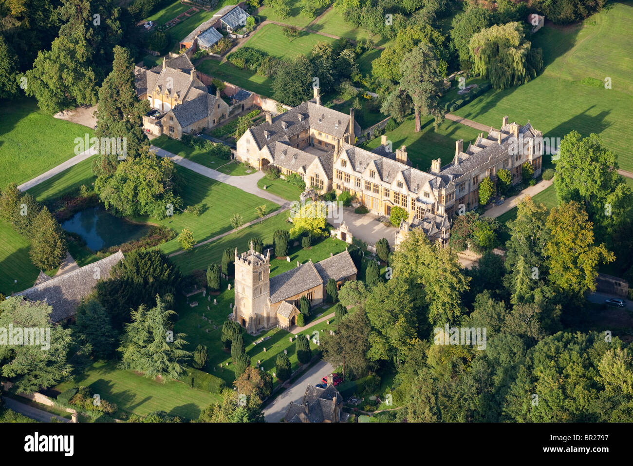 An aerial view of Stanway House and St Peters church in the Cotswold village of Stanway, Gloucestershire from the Stock Photo