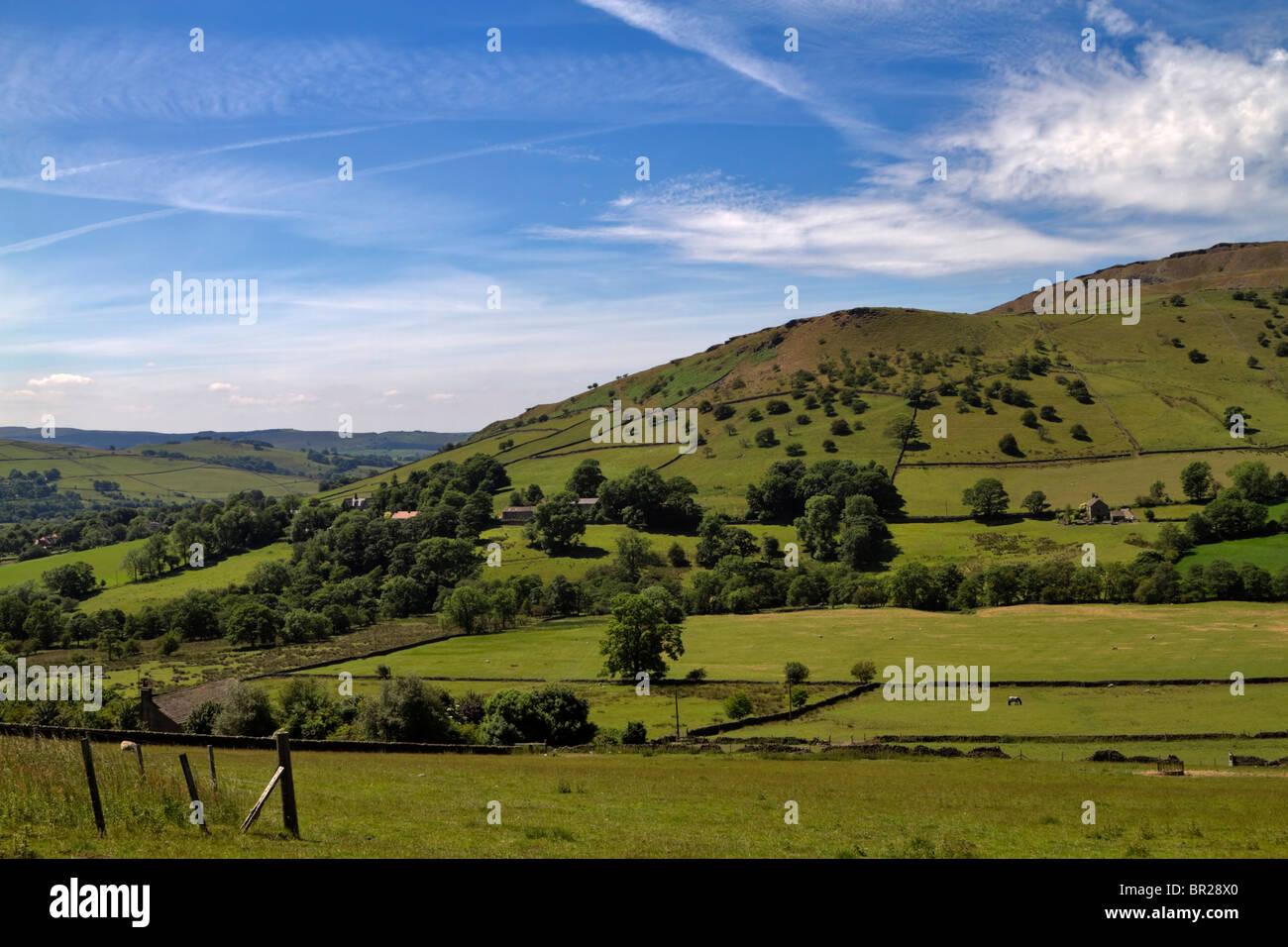Dark Peak Area, Peak District, Derbyshire. Rolling farmlands on the Hayfield Road near Chinley Head. - Stock Image