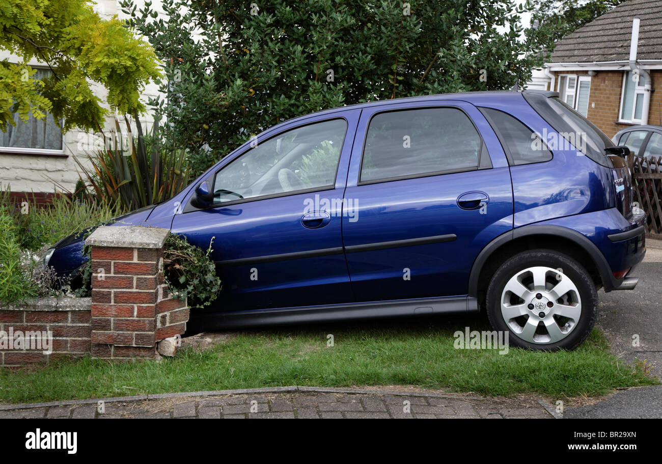 Car Embedded in Garden Wall - Stock Image