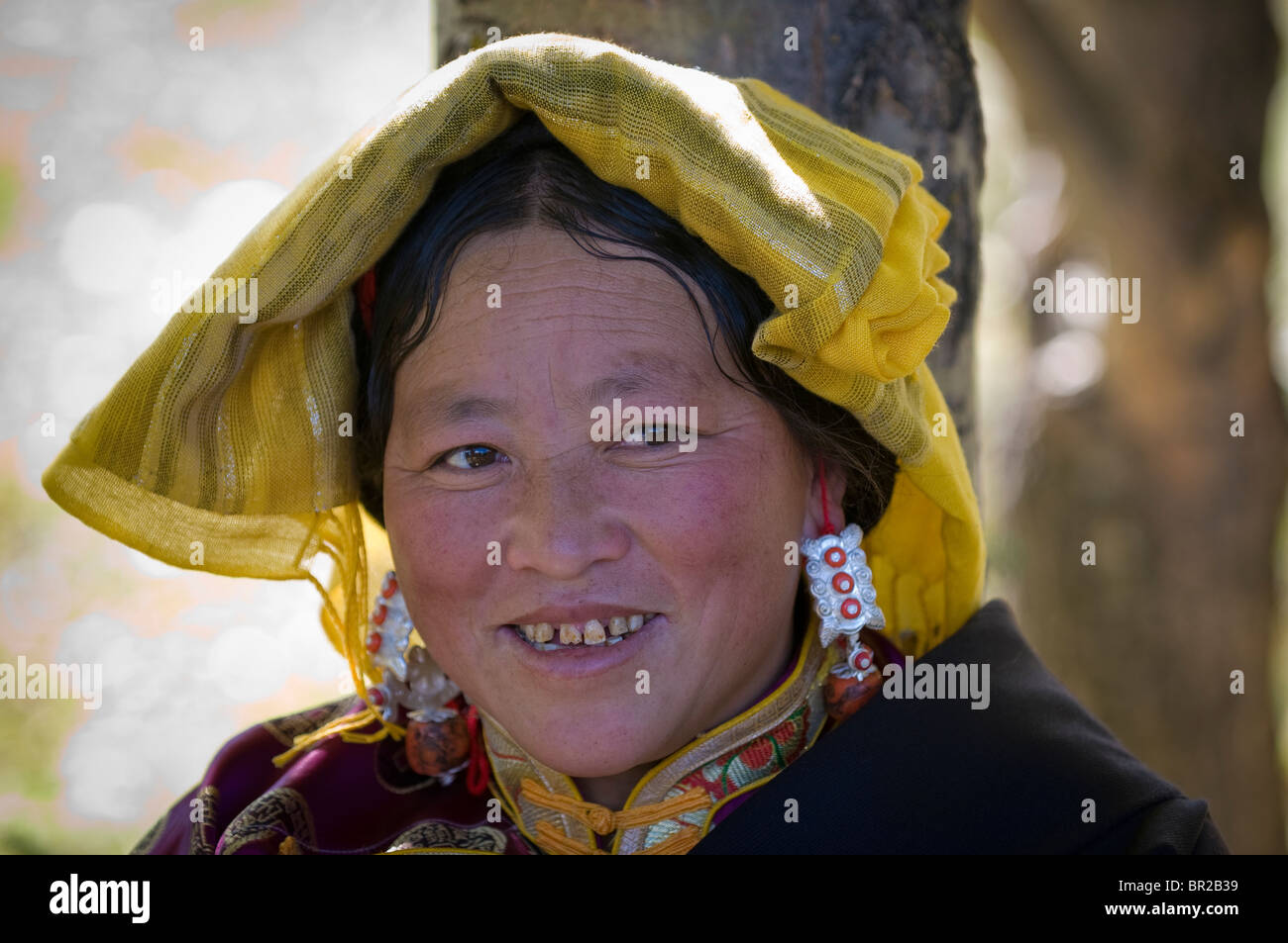 Ethnic Tibetan woman wears traditional costume at weekend festival, Bamei, Sichuan Province, China - Stock Image