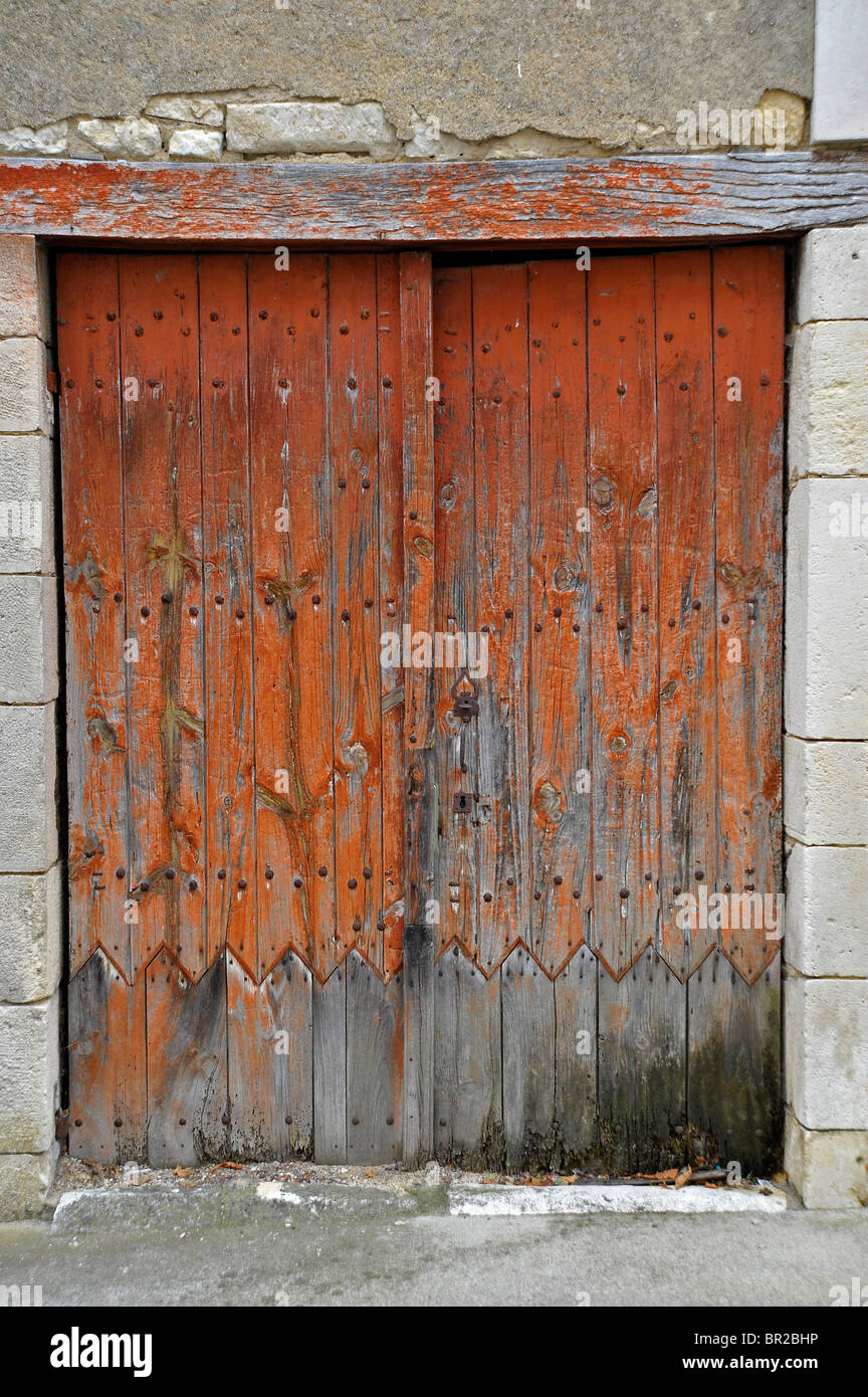 Old weathered wooden painted doors - Stock Image
