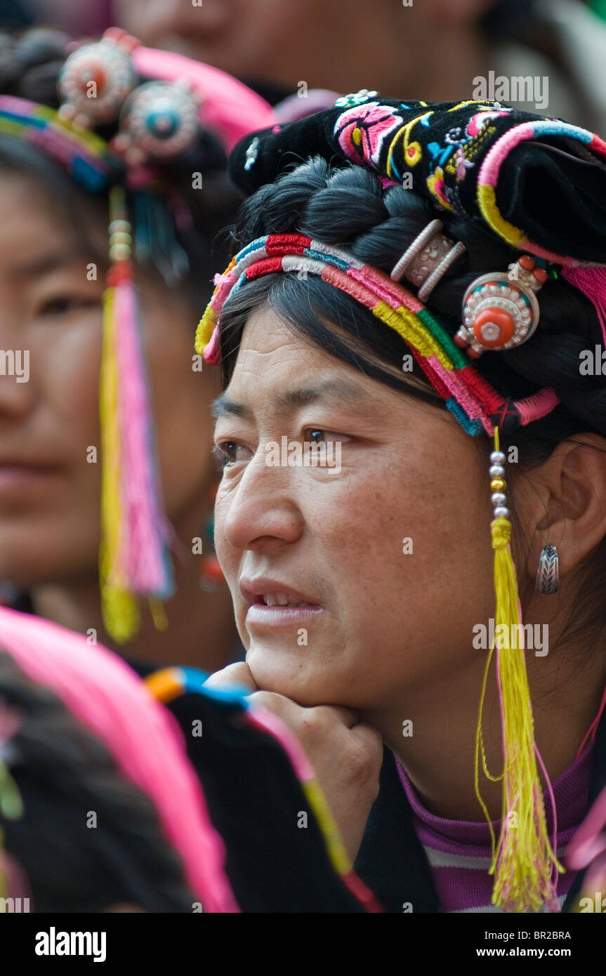 Woman attends ethnic Tibetan dance and folk festival, Danba, Sichuan Province, China - Stock Image