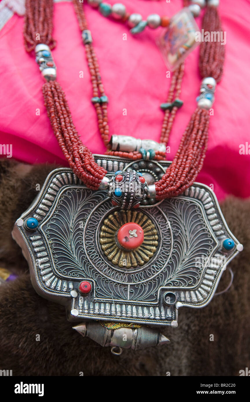 Silver necklaces adorn female ethnic Tibetan dancer at folk festival, Danba, Sichuan Province, China - Stock Image