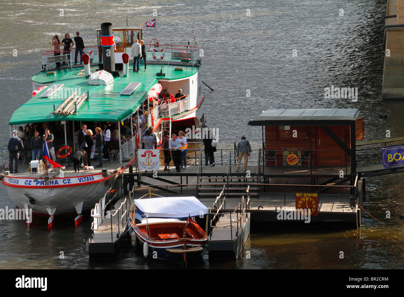 Wharfing (boat landing - laddering) boat at Vltava River, in Prague, Czech Republic August 2010 - Stock Image