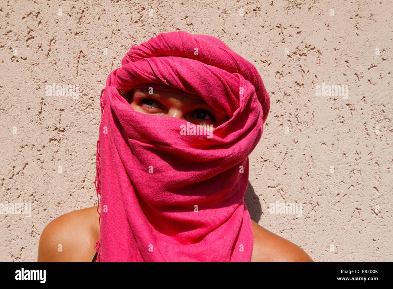 Girl Wearing Pink Headscarf - Stock Image
