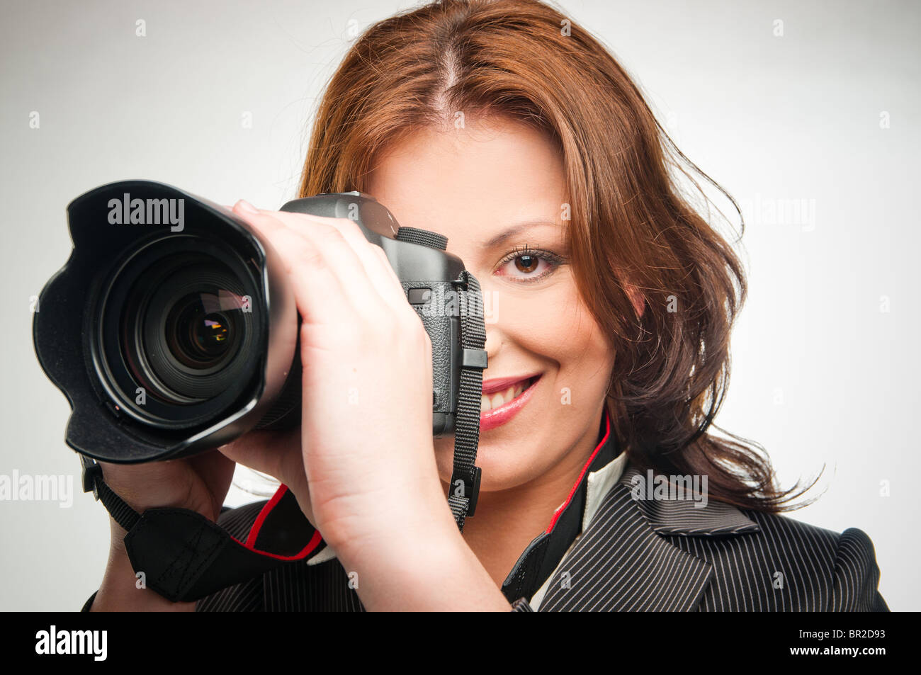 young girl with photocamera - Stock Image