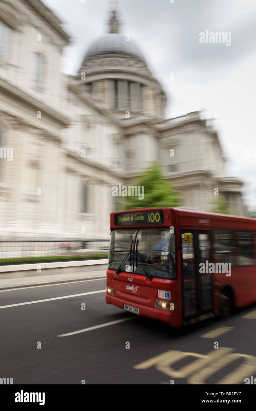 London bus hurtling past St Paul's Cathedral Stock Photo