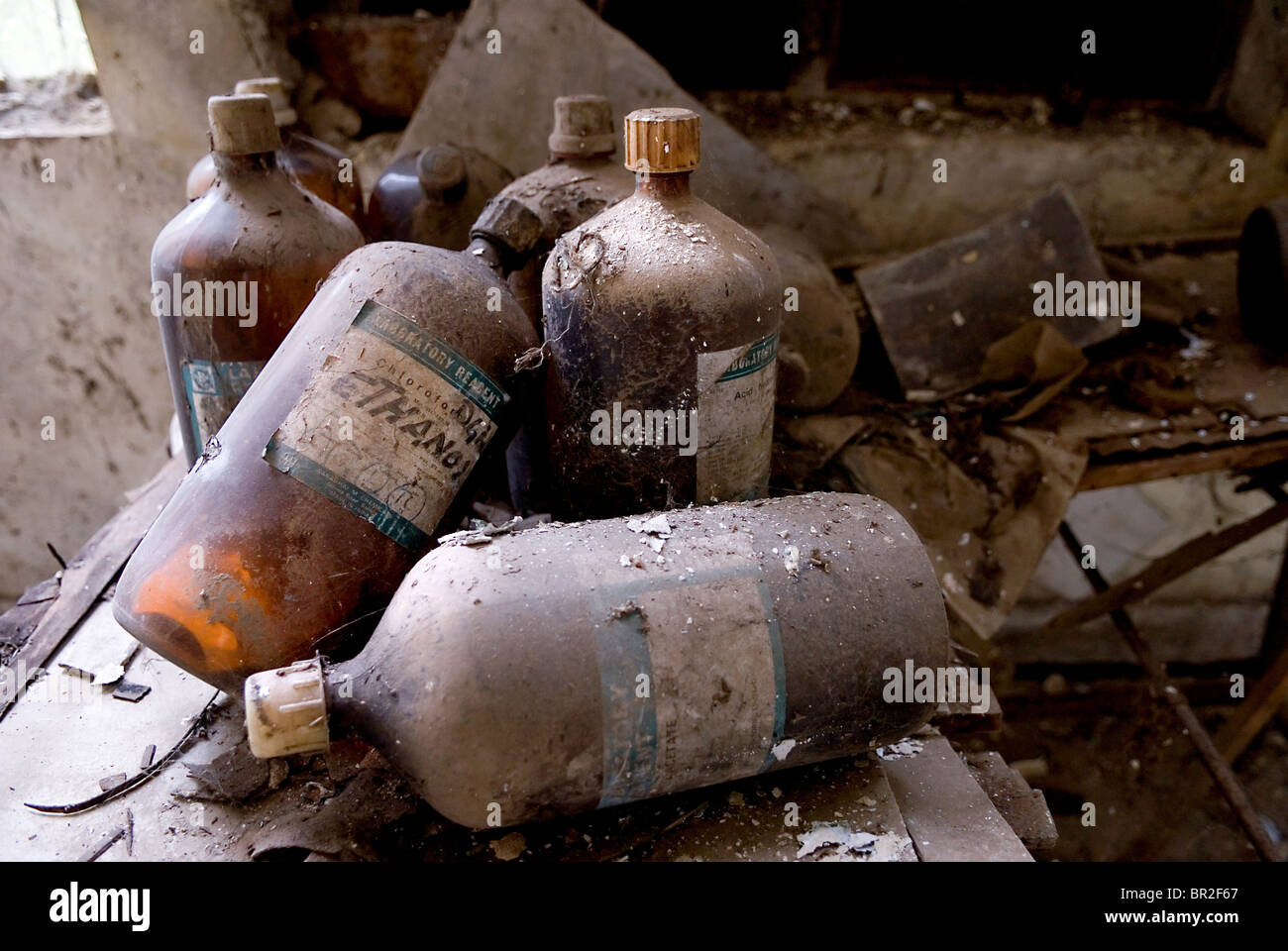Bottles of Ethanol lie amongst the debris of the derelict Union Carbide factory. Stock Photo