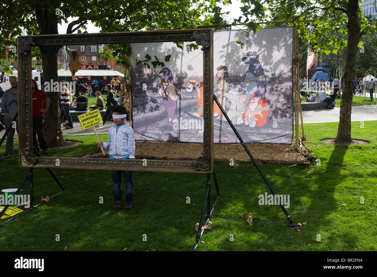 Backdrop of Banksy / Disney Jungle Book characters to illustrate de-forestation & loss of animal habitats due to Stock Photo