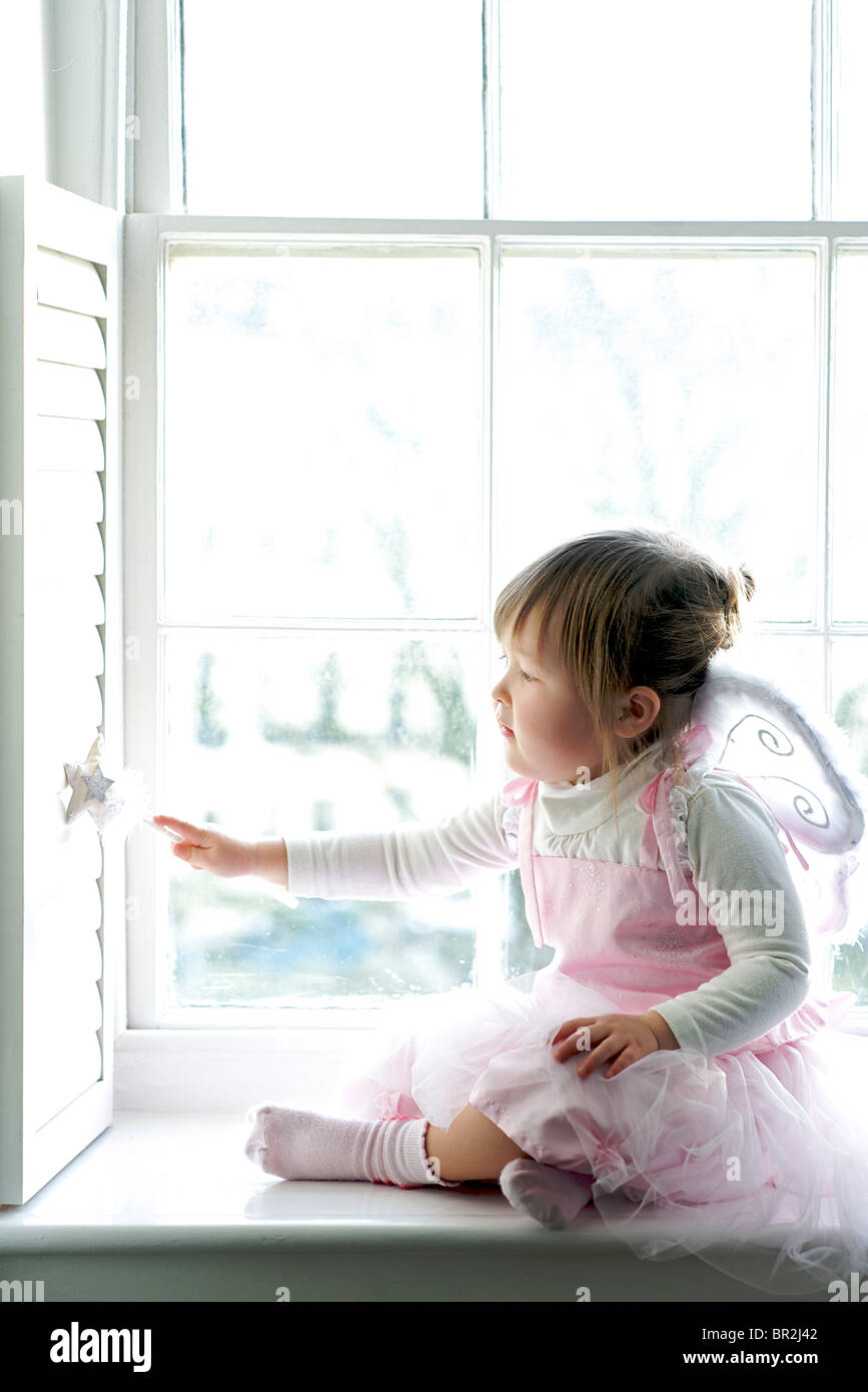 Toddler age 2-3 in a fairy outfit with a wand. MODEL RELEASED - Stock Image