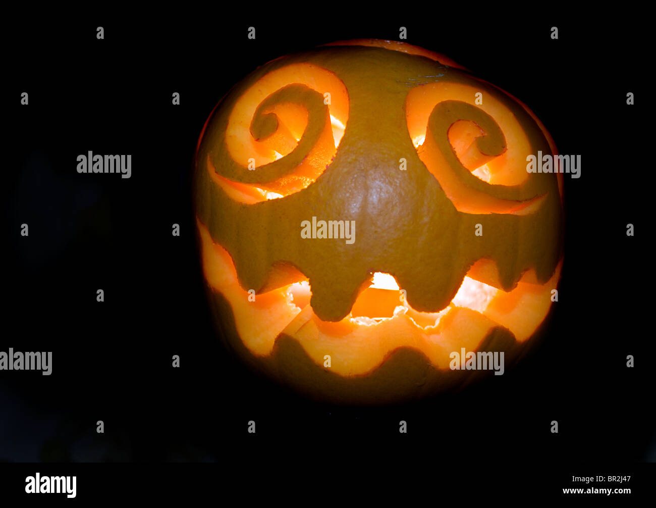 Halloween pumpkin against black background - Stock Image