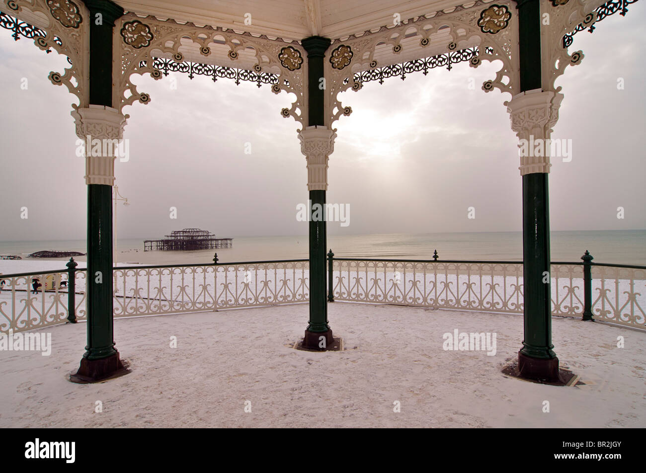 Brighton beach and bandstand in snow. Brighton, East Sussex, England - Stock Image