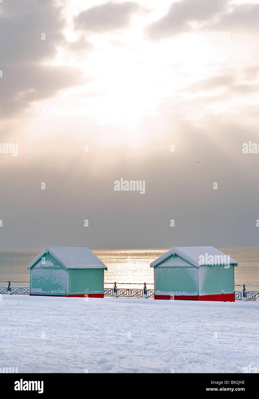 Beach huts on Hove promenade in snow. Winter. Brighton & Hove, East Sussex, England Stock Photo