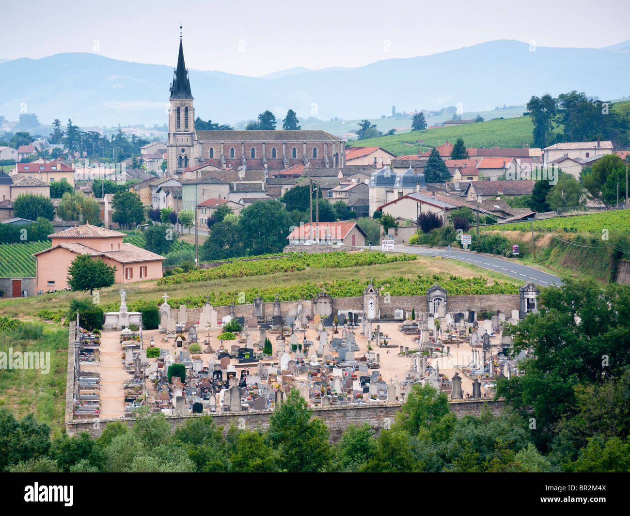 Graveyard and church at Fleurie in Beaujolais, France - Stock Image