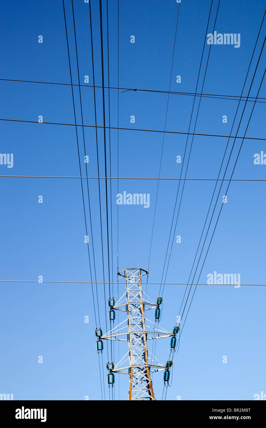 High-voltage power lines and metallic pylon - Stock Image