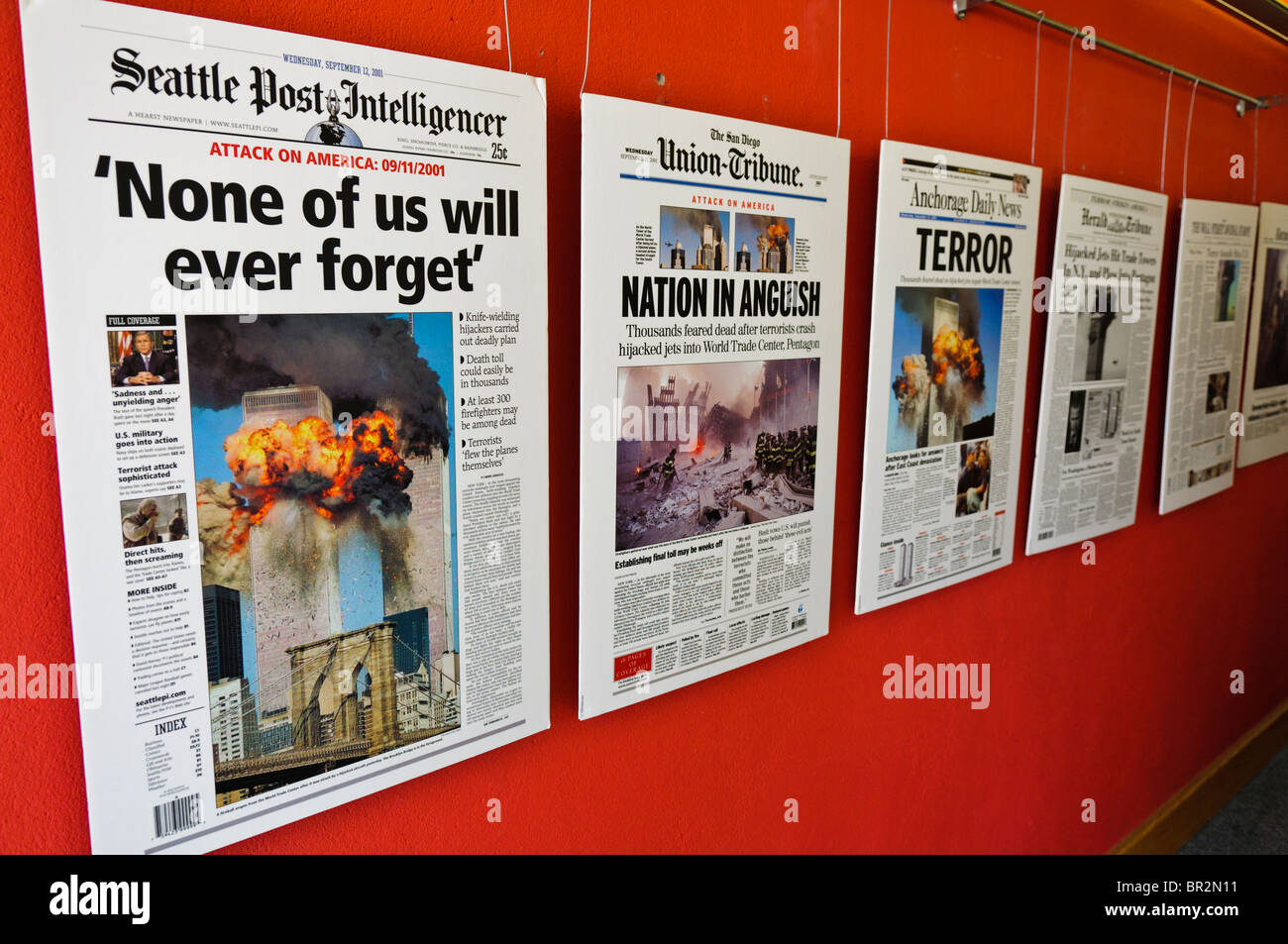 Newspaper front covers in an exhibition commemorating 9/11 2001 Stock Photo