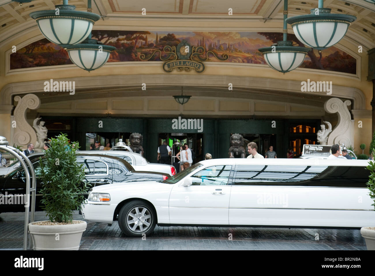 A white limousine at the entrance to the Bellagio Hotel, the Strip, Las Vegas Nevada USA - Stock Image