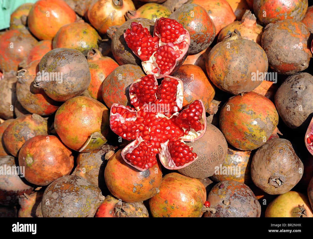 Pomegranates on a market stall, Kerala, India - Stock Image