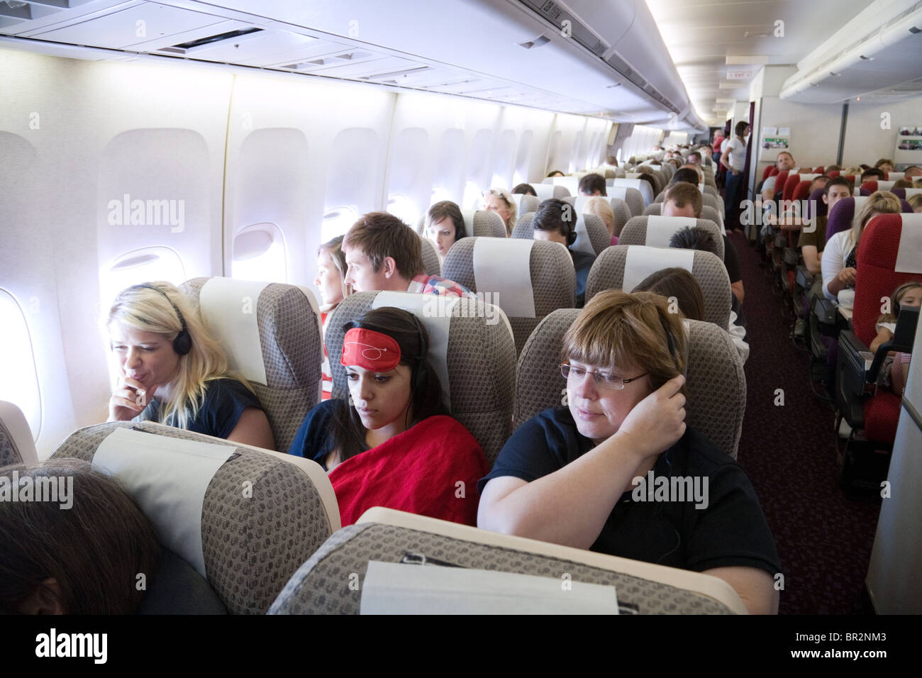 passengers flying in a Virgin Atlantic Boeing 747 from Gatwick to Las Vegas - Stock Image