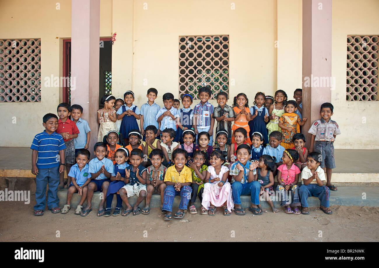 Schoolchildren in a group portrait, Kerala, India - Stock Image