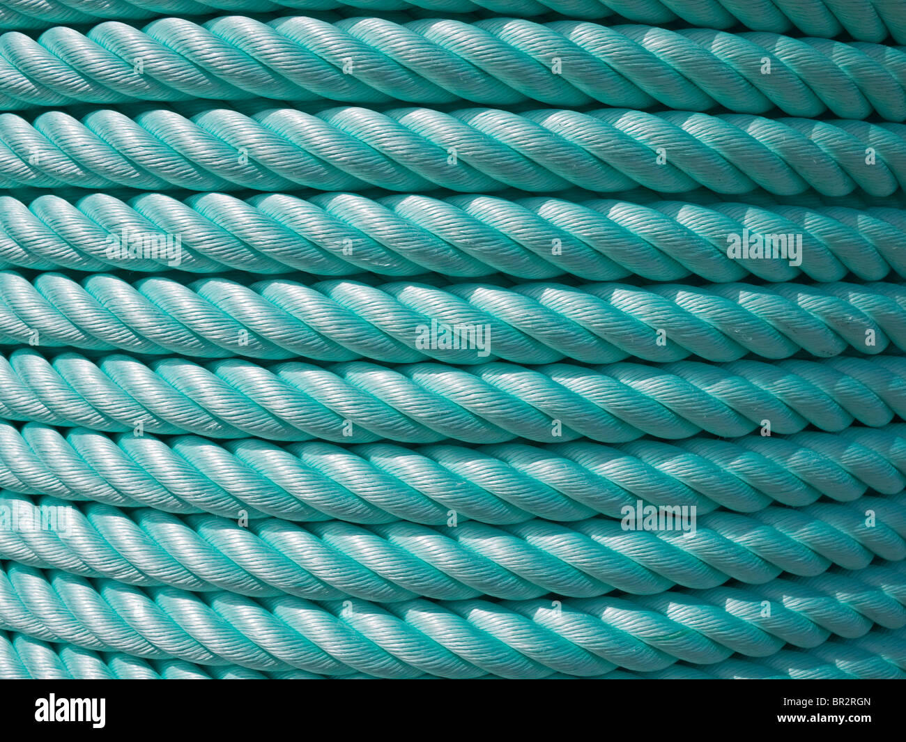 Close-up of thick green nylon rope cable - Stock Image