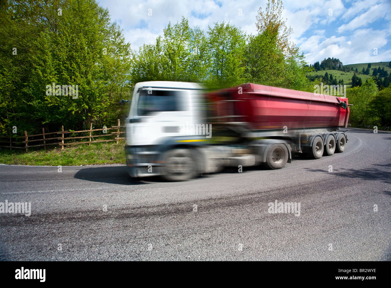 Big truck with trailer speeding on a road, with motion blur Stock Photo