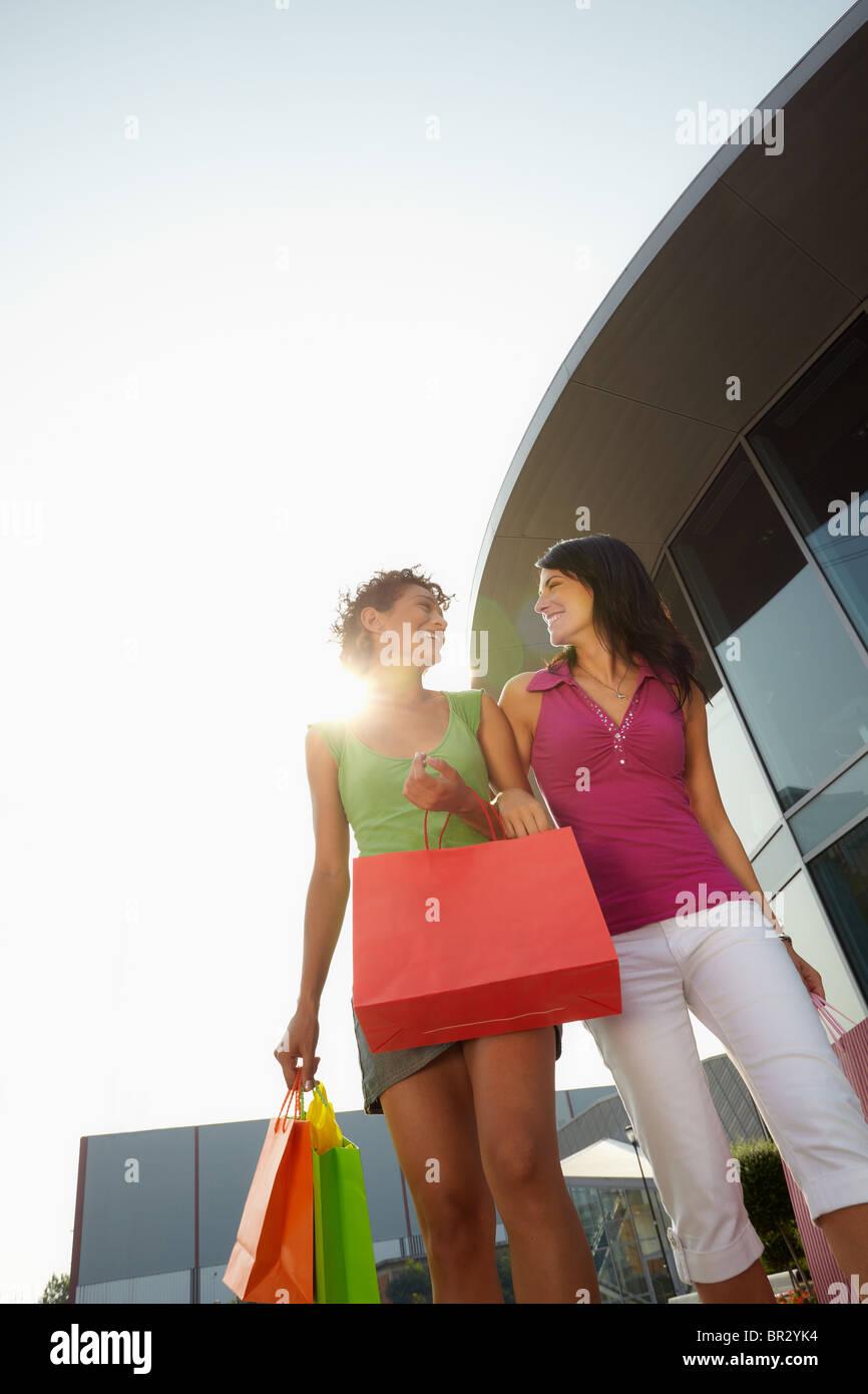 two women carrying shopping bags Stock Photo
