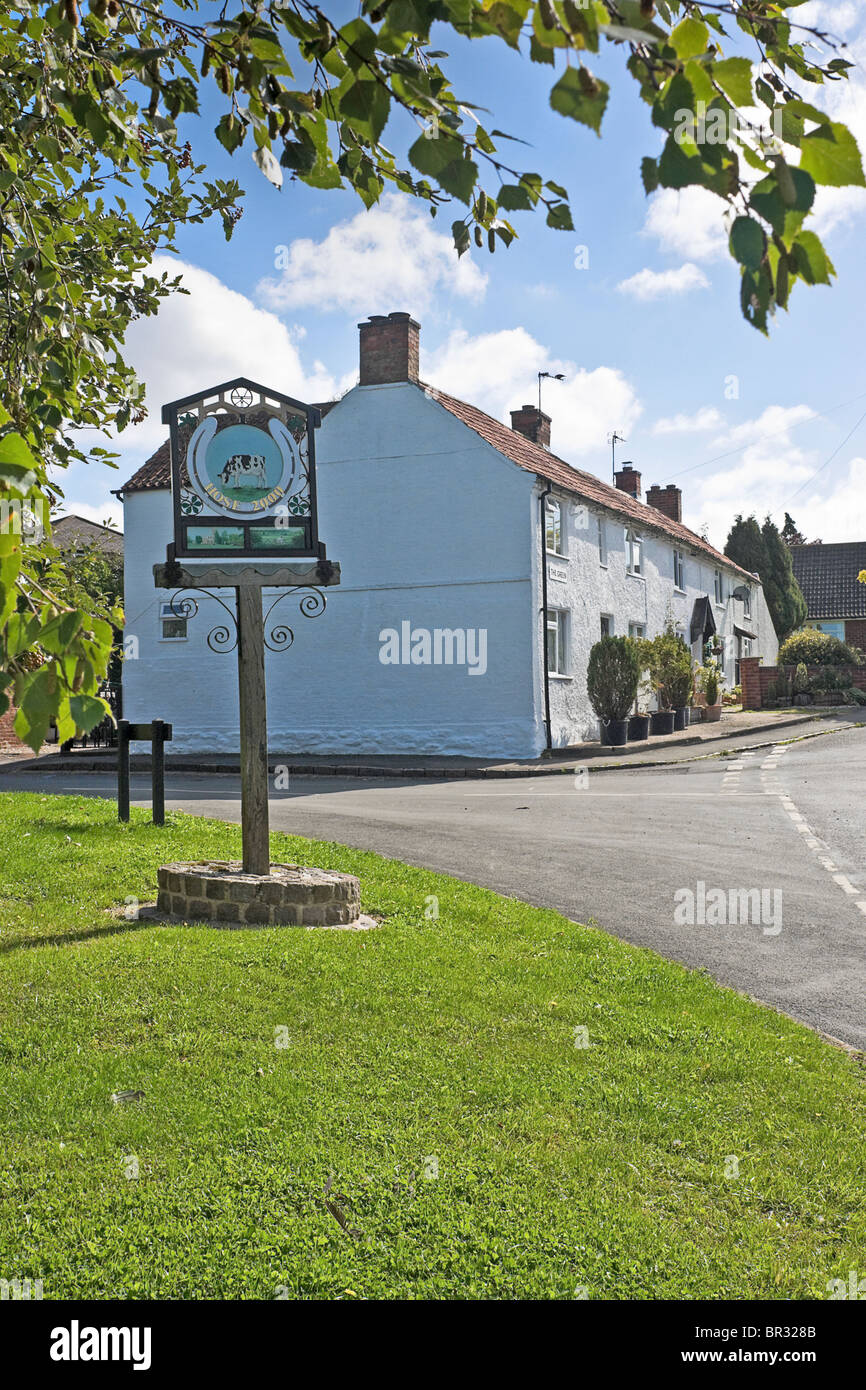 The village green at Hose in Leicestershire. The sign commemorates the millenium. - Stock Image