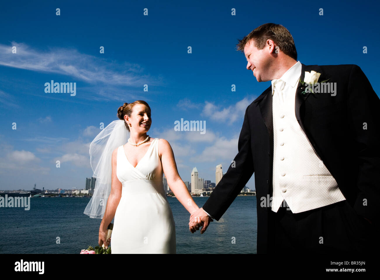 A bride and groom in Coronado, CA. - Stock Image