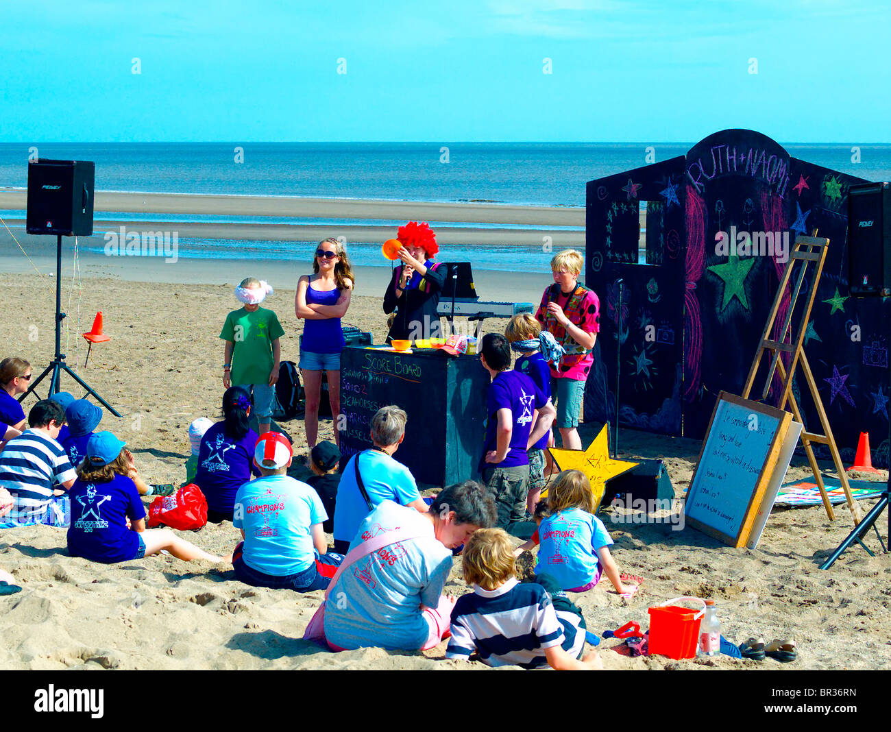 Beach entertainers,entertaining fanilies on the beach at Sutton-on-sea,Lincolnshire,UK. - Stock Image