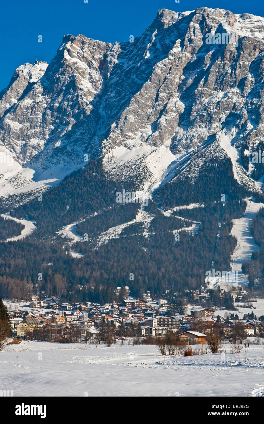 Snow-covered village in front of the panorama of Mt Zugspitze, Ehrwald, Zugspitz Arena, Tyrol, Austria, Europe - Stock Image