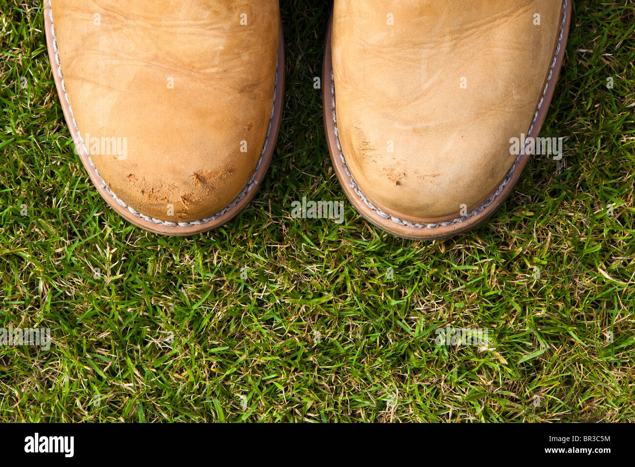 Pair of boots on grass - Stock Image